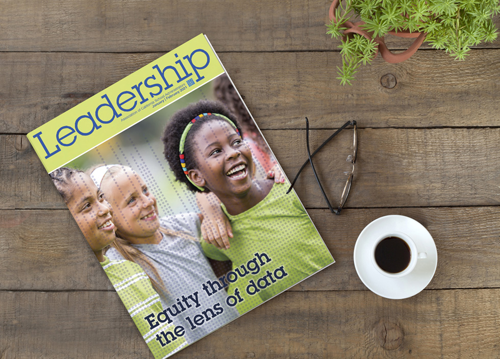 Leadership magazine on a table with eyeglasses and coffee.